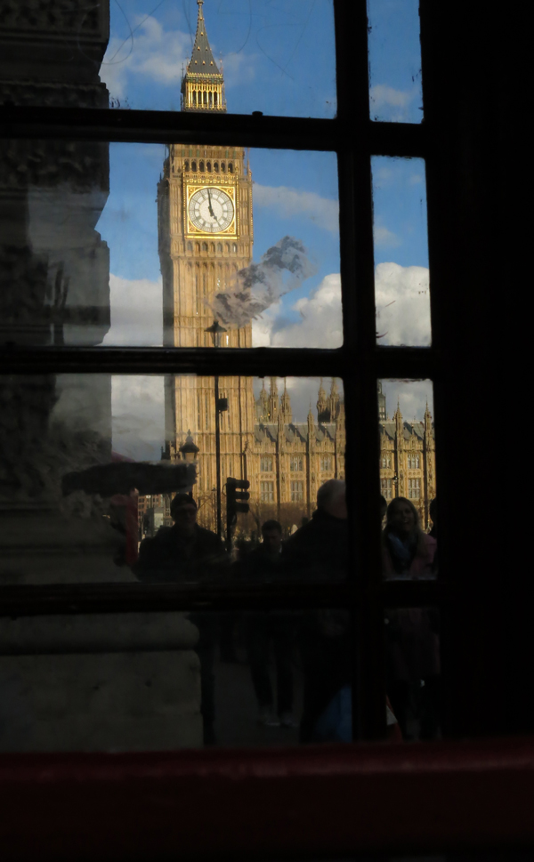 Big Ben is seen through the windows of a London phone booth.
