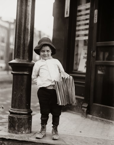 """Newsboy"" by Lewis Hine, circa 1910"