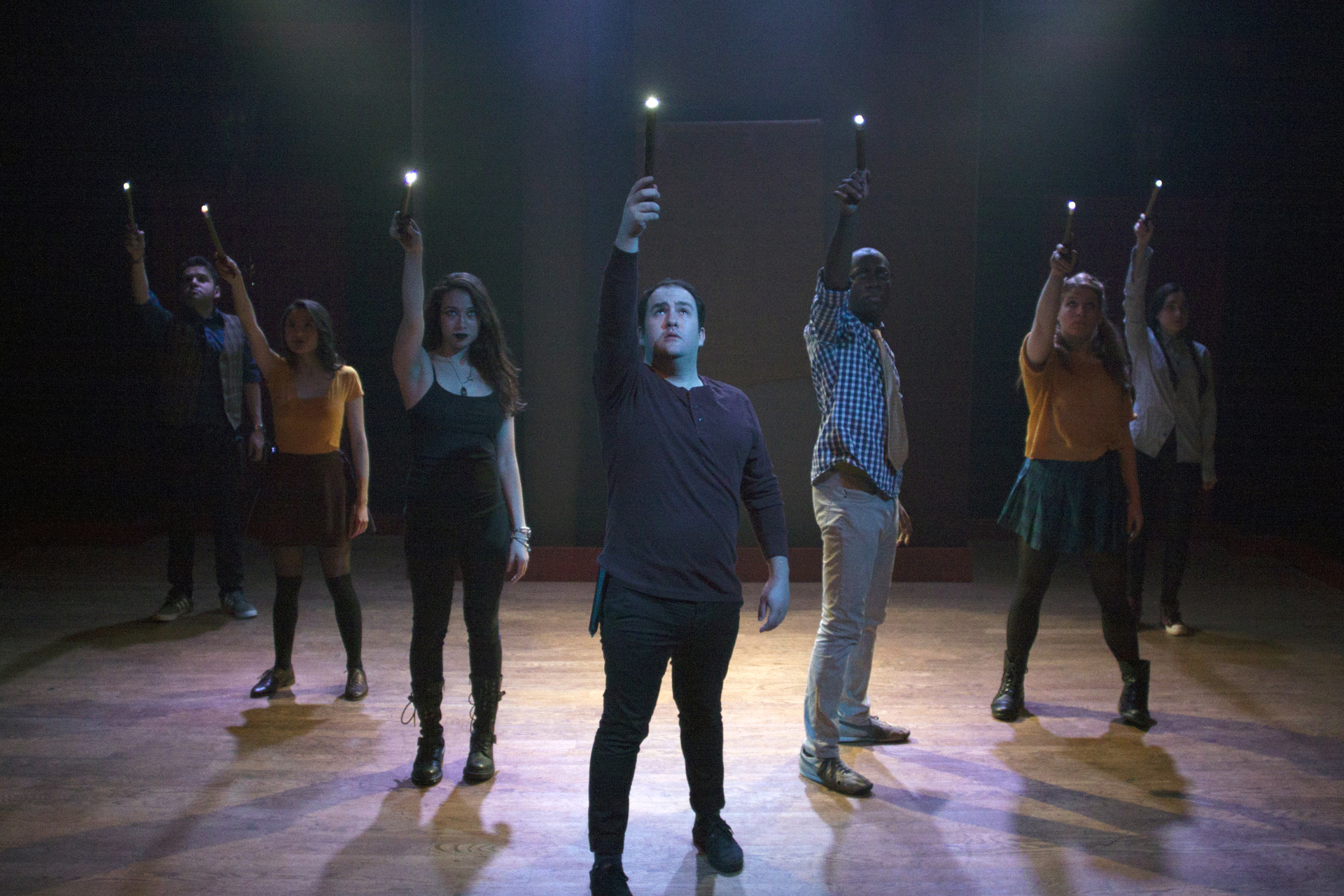 The stars of PUFFS, including Zac Moon, (center) and Troy High grad Andrea Miller (second from right) brandish their wands. photos courtesy of Lloyd Mulvey